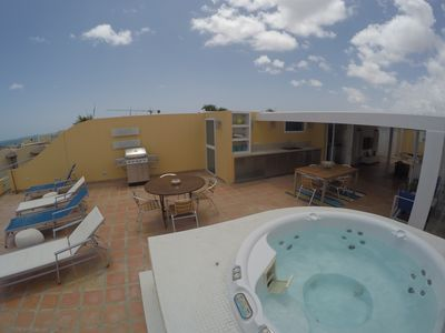 roof top hit tub, lounge chairs and dining space...great for a BBQ