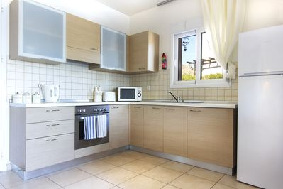 Well stocked kitchen with all you'll need.