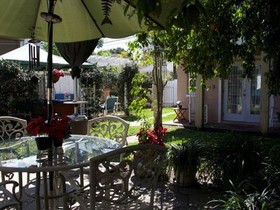 Photo for Near Downtown-Carriage House nestled in a Secret Garden-Perfect for a Couple