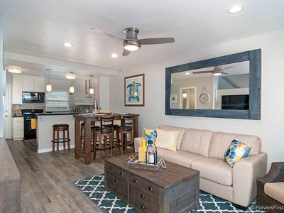 Photo for ☀️WATERFRONT 🏝Remodeled Family Beach Condo- Kid Friendly, BBQ, Waterfront Ground Floor Patio!