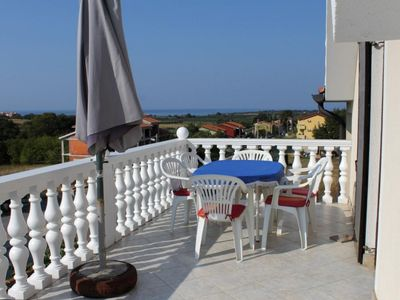 Photo for Two bedroom apartment with terrace and sea view Novigrad (A-7037-a)