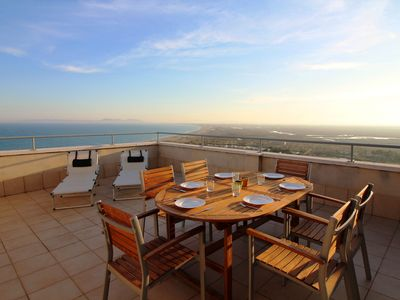 Photo for Apartment with sea view, walking distance to the beach