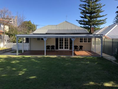 Photo for 5 mins walk to beach, 2 BR renovated cottage with large sunny garden