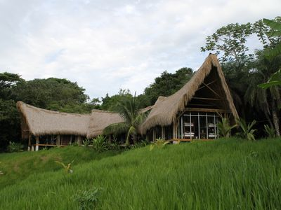 Stunning glass  villa with thatch roofs , an amazing view!