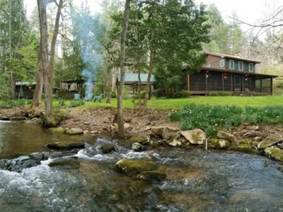 Photo for Peaceful creekside cabin w/ wood-burning fireplace, firepit, & screened-in porch