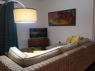 Comfortable sitting area with Internet, TV and Alexa Dot for entertainment.