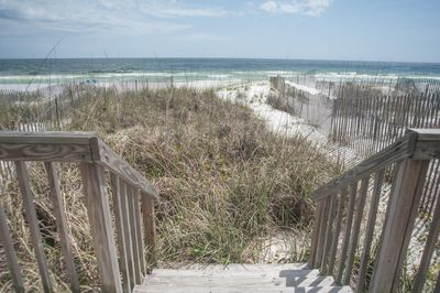 Stairs leading you to the white sandy beaches