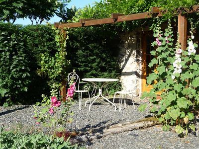 Dine amongst the hollyhocks in the private west-facing garden
