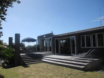 Sun drenched retreat two minutes from the beach