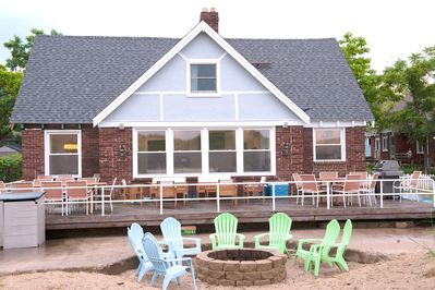 Deck/Patio offers dining for 16 plus sectional sofa area and fire pit.