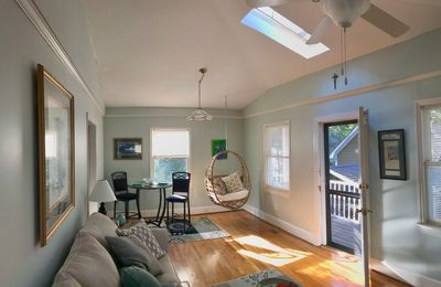 panning from front door to Spacious living area below vaulted ceiling &skylight.