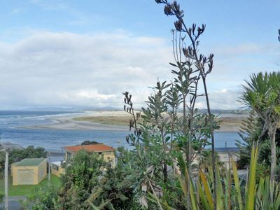 Photo for Sandy Feet - Classic, modest kiwi bach with stunning views a few steps to surf beach and estuary