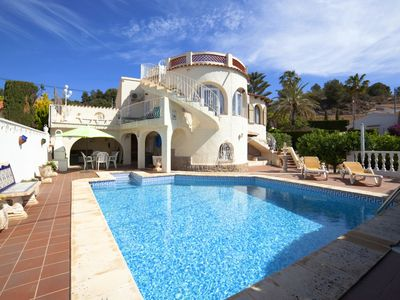 Photo for This 4-bedroom villa for up to 8 guests is located in Calpe and has a private swimming pool and air-
