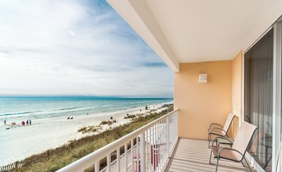 Photo for New Listing! Updated beachfront condo w/sunset views! 4 pools & poolside dining!