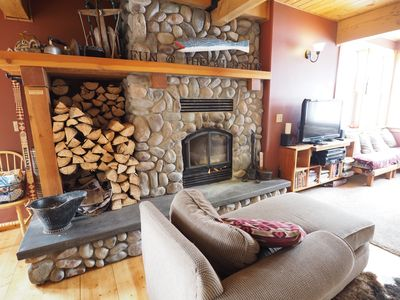 The comfortable lounge room provides amazing views of the ski hill and a wood burning fireplace