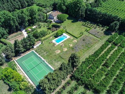 View to he house, the garden, the pool, the tennis court and part of the orchard