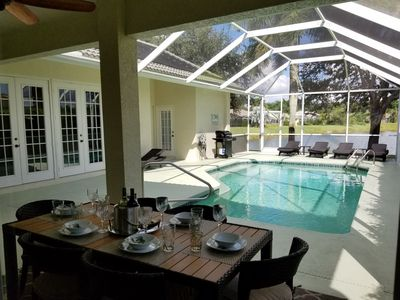 Pool area with dinning table