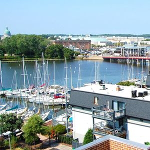 Photo for This fabulous condo is picture perfect with its furnishings and appointments. Enjoy a short walk into town to grab your morning coffee and newspaper. When you live here, you are within blocks of fabulous eateries, many of them right on the water.