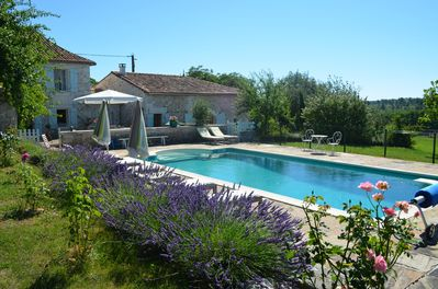 View of the farmhouse and converted barn with swimming pool.