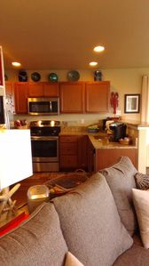 Kitchen has full size appliances, a keurig and basic spices for cooking.