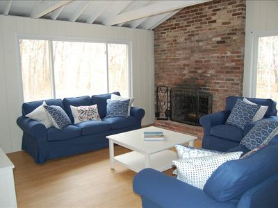 Recently furnished family room w/ cable TV, fireplace,  new floors. Clean!