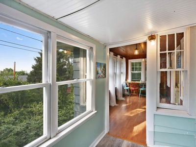 Photo for Outdoor living steps from the beach with great lake views! Great location