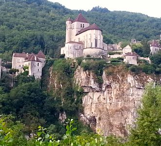 St Cirq from across Lot River - house is on the cliff, to right of the chuch