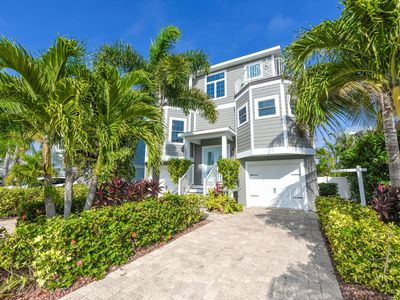 Photo for Steps Away from Beach Access- Beautiful Pool and Outdoor Living Area