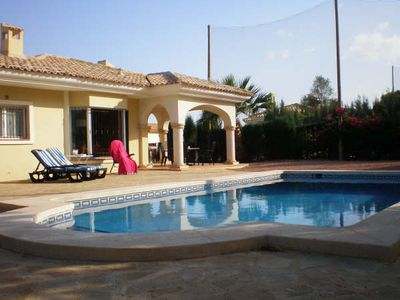 Backgarden of villa with private pool, sunterrace and covered terrace