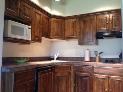 Full kitchen with cook top, microwave, fridge and most utensils. Gas grill also.