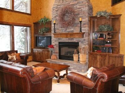 2 story great room with floor to ceiling Rock Fireplace
