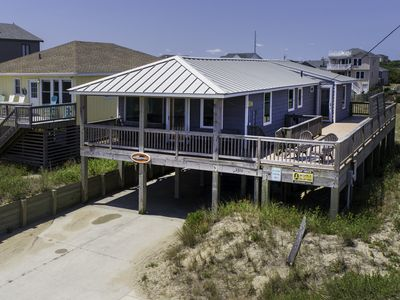 Photo for Semi Oceanfront! Relax on your front deck watching sunrises over the ocean!