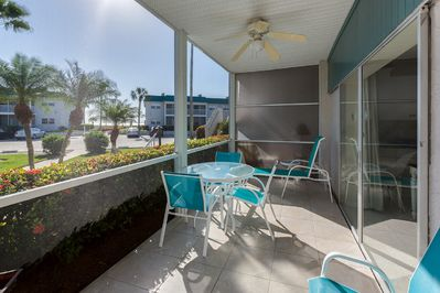 Our bright & comfortable front lanai with a view of the Gulf and beach.