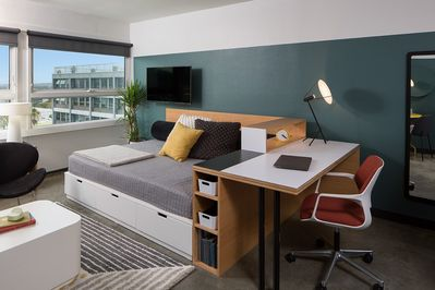 Queen Size Bed  (Actual apartment is similarly furnished and styled)