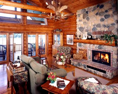 Photo for Georgeous 7 Bedroom Log Lodge Sauna 2 Fireplaces Game room Wi-Fi Slps up to 24