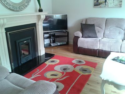 Large comfy sitting room with large 3 seater settee and 2 armchairs