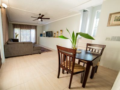 Large living room area with dining table