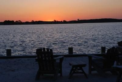 Photo for FREE ACTIVITIES!  Water front with fabulous water views and gorgeous sunsets await you from the spacious bay front deck
