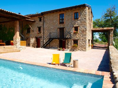 Villa Cal Pesolet in summer, with private patio, porch and pool.