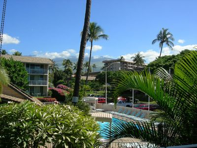 Your view from our lanai looking over the pool, and  gardens to Mt. Haleakala