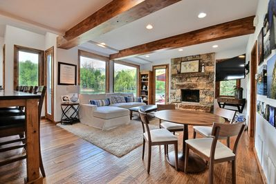 living room and dining nook with view of lake and mountains