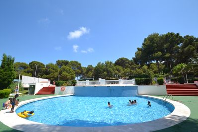 The children's area in the swimming pool, sunny, is equipped with waterfalls