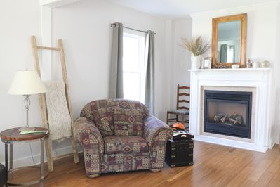 Relax and enjoy the gas fireplace in the living area.