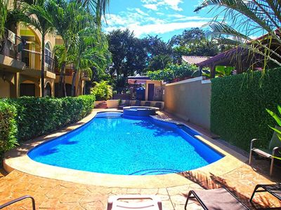 Photo for Renovated Spacious Condo a Short Walk to the Beach with Beautiful Pool