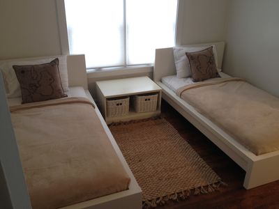 Second floor bedroom with two twin beds/ window air conditioner unit