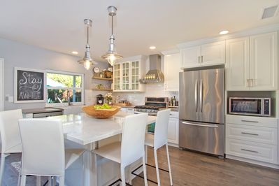 Large kitchen islands perfect for gatherings.