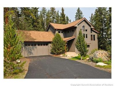Fantastic custom home that backs to thousands of acres of forest out your back door!  2 car heated garage, flagstone entry with landscaped front yard.