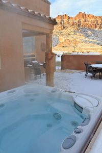 Hot tub with views of the Moab rim in one direction, La Sal Mountains the other.