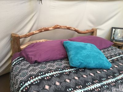 The hand-made queen bed