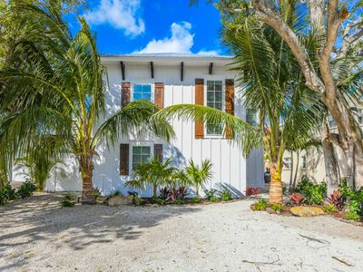 Photo for 7 Bedroom Home w/ WATERSLIDE. Heated Pool. SPA. SLEEPS 23 in Beds. Walk to Siesta Key Beach and Village. Property Manager Included.